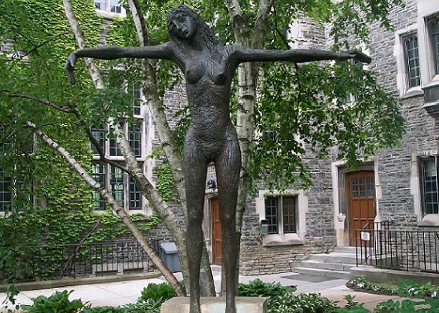 Nude female crucifixion art